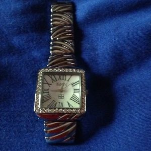 New in box IMAN silver tone watch $79