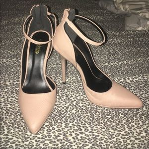 Nude ankle strap pumps.