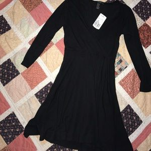 Little black midi dress. Mid sleeves.