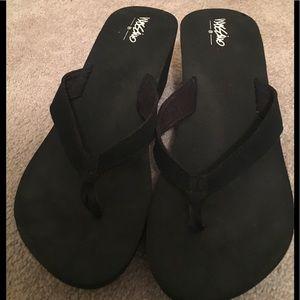 Black platform flip flops