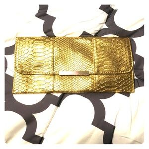 Expressions NYC Gold Snake Printed clutch