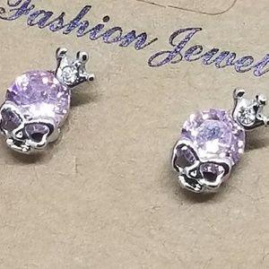 Skull stud earrings  pink