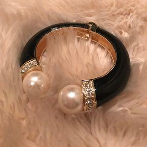 Hinged black bracelet with rhinestones and pearls