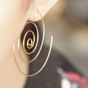 Gold spiral statement earrings........