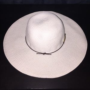 White floppy hat with brown cord