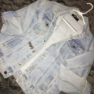 Jean jacket embellished with patches