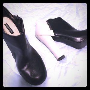 Shoe meant half black half white heels size 11