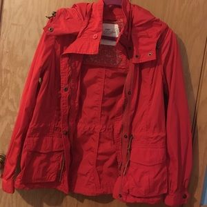 Adorable red/orange windbreaker jacket