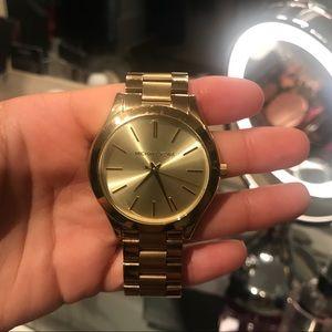 Michael Kors stylish unisex gold watch.