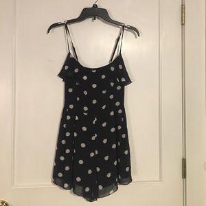Cute navy blue and white polka-dot romper!