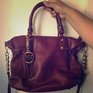 MK burgundy leather handbag with crossbody strap