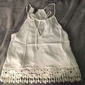 Shear white tank top with lace detailing at bottom