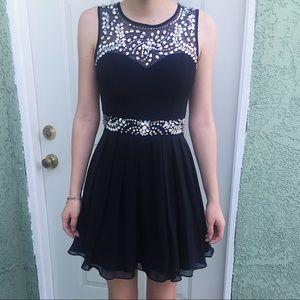 Black embellished black dress