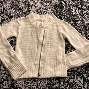 Knitted women white cardigan with asymmetrical zip