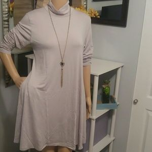 Light grey loose-fitting turtleneck dress