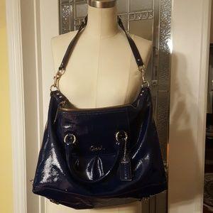 Used blue shiny leather Coach purse