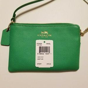 COACH Kelly green wristlet