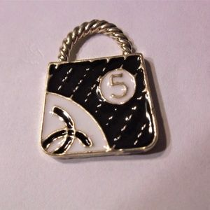 CHARM, GOLD TONE BAG  WITH WHITE AND BLACK ENAMEL