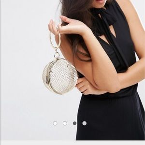 Golden sphere clutch/bag