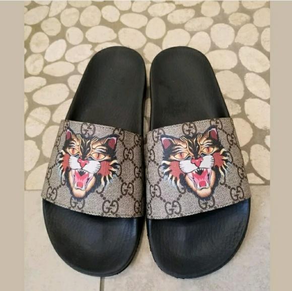 e56a3a29167 Gucci Shoes - Gucci Pursuit Tiger Print GG canvas Slide Sandals