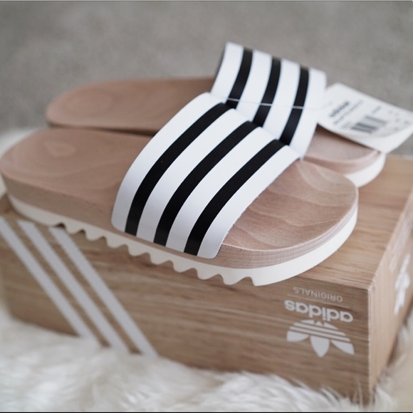 cff8bf0e86e221 Adidas women s  adilette  REAL wood slides