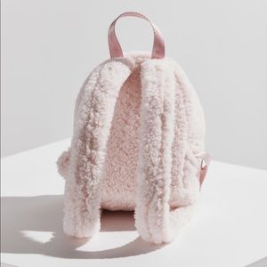 9a4d03c714e6 Urban Outfitters Bags - Fluffy Pink Mini BackPack - Urban Outfitters