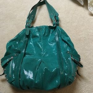 Turquoise HYPE leather shiny bag with metal studs