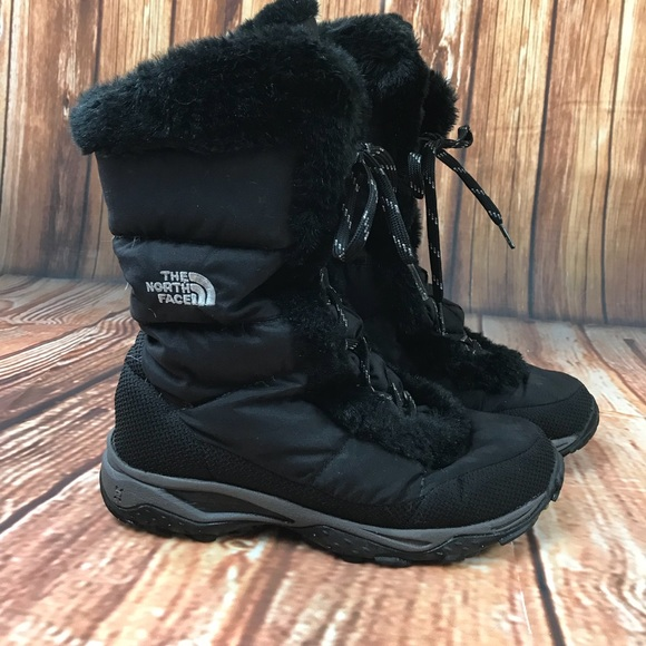 a24fa5848 The North Face black lace up boots goose down fur