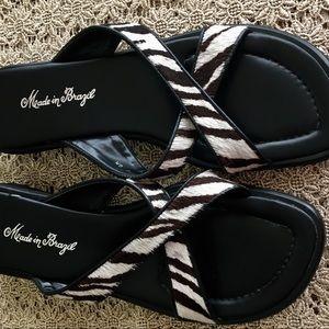 Black and white animal skin leather slides