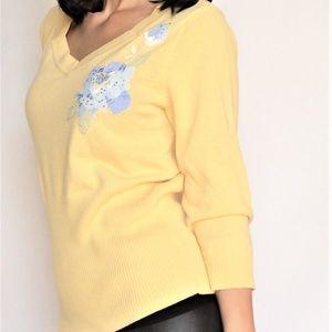 Emma James yellow sweater
