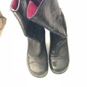 XOXO black leather boots.