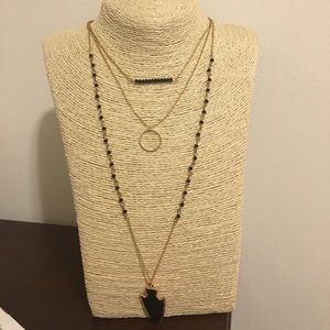 Gold and black multi layered necklace