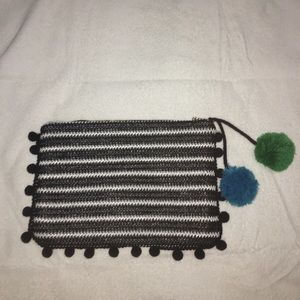 black and white purse blue green black pom poms