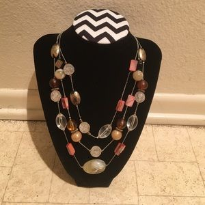 Clear brown and coral colored statement necklace