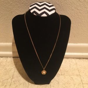 Gold colored faux pearl necklace