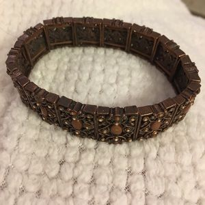 Stretch bronze bracelet fits all. Great for layers