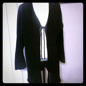 Black sweater cardigan.  Has a tie in front