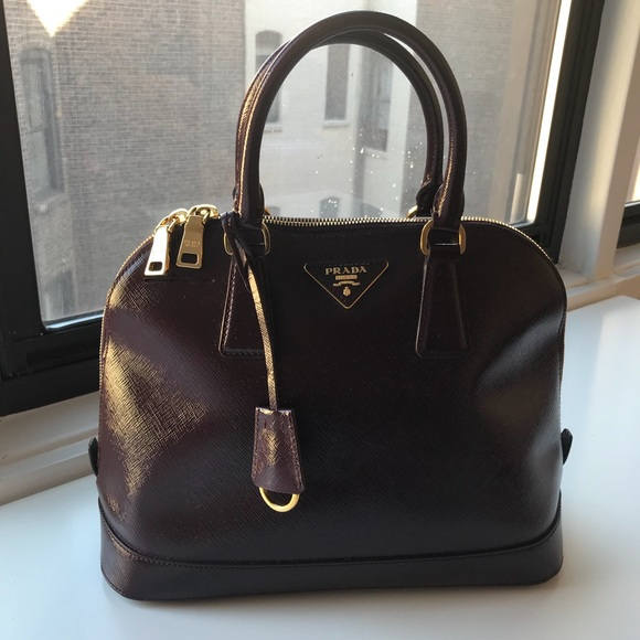 be11b9f862a7 Prada top handle leather bag in burgundy. M 59f353c256b2d6c84701368e