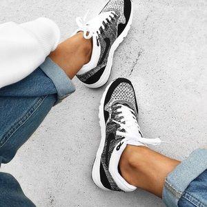 Nike Black + White Ultra Flyknit Sneakers