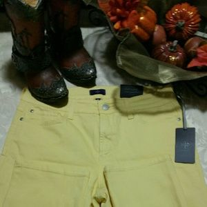 A pair of yellow NYDJ SKINNY JEANS