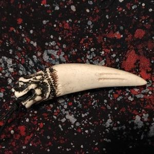 Jewelry - Hand carved tree sap tooth pendant