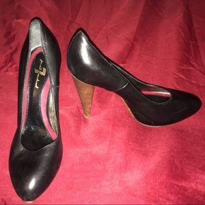Black heels. Wooden heel. About 4 inches.