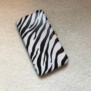 Hard cover zebra print wallet!