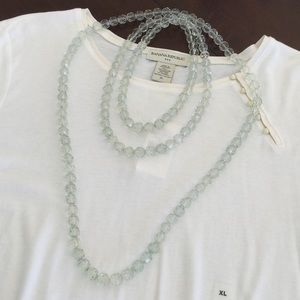 2 strands of clear green faceted beads
