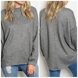 Long sleeve relaxed fit knit top mock neckline.