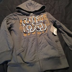 NWT boys fleece lined zip up sweatshirt. Size M