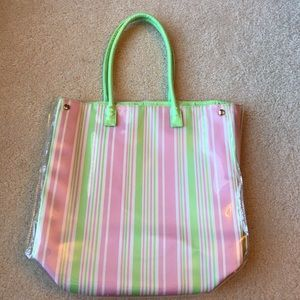 Estée Lauder tote, pink and green, clear vinyl out