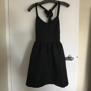 Dresses & Skirts - Black backless cocktail dress with bow