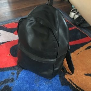 COS Rounded Black Leather Backpack