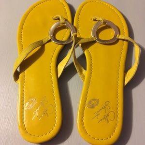 Bright sandals.